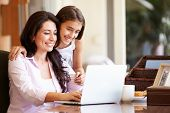 foto of 13 year old  - Mother And Teenage Daughter Looking At Laptop Together - JPG