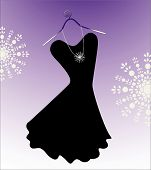 stock photo of little black dress  - Chic little black dress with beads and hanger - JPG