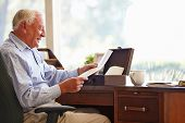 image of keepsake  - Senior Man Putting Letter Into Keepsake Box - JPG