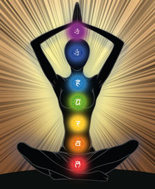 foto of tantra  - Woman silhouette in yoga position with the symbols of seven chakras - JPG