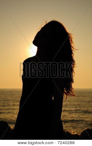 Silhouette Of Sunset Girl