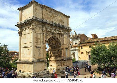 Tourists In Square Near The Triumphal Arch Of Titus In Rome, Italy