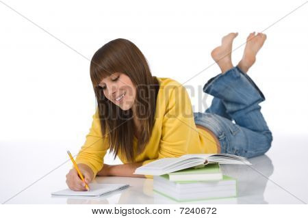 Happy Female Teenager Write Homework