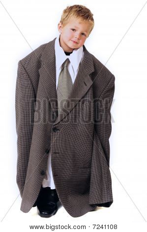 Boy in oversized business clothes