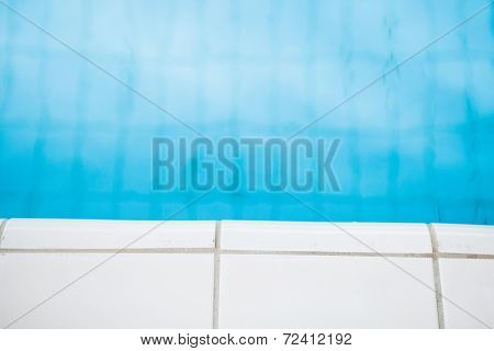 Edge Of Swimming Pool With White Tiles
