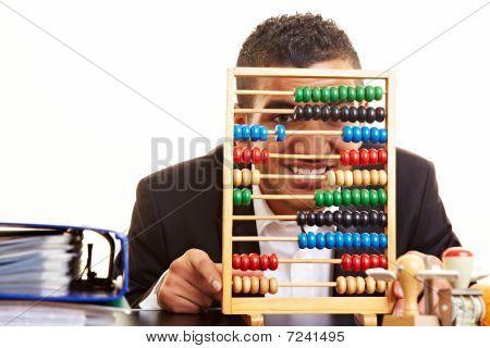 Man Looking Through Abacus
