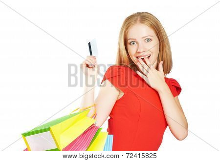 Happy Woman On Shopping With Bags And Credit Cards Isolated On White