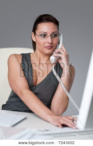 Executive Businesswoman Calling At Office