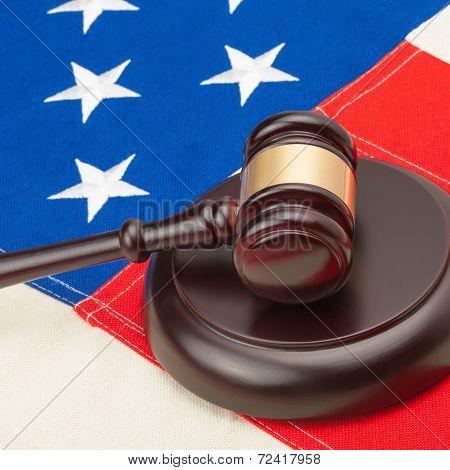 Wooden Judge Gavel And Soundboard Laying Over Usa Flag - Closeup Studio Shoot