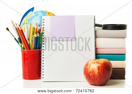 Globe, notebook stack and pencils isolated