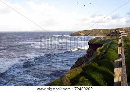 Cliff Path And Storm Waves