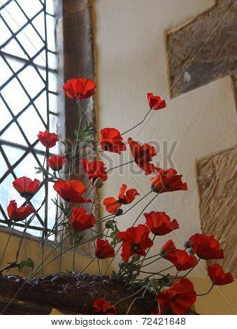 Poppies in church window