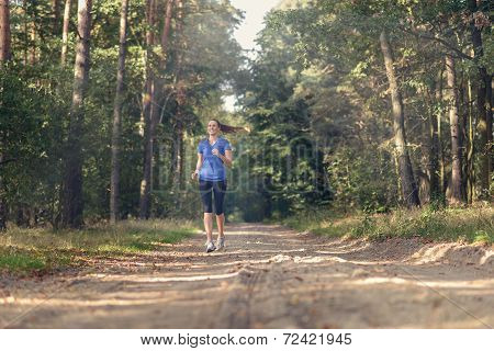 Athletic Woman Out Jogging In A Forest