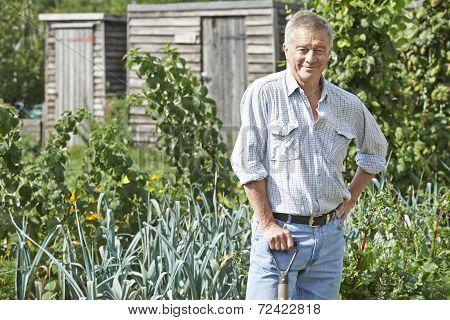 Portrait Of Man Gardening On Allotment