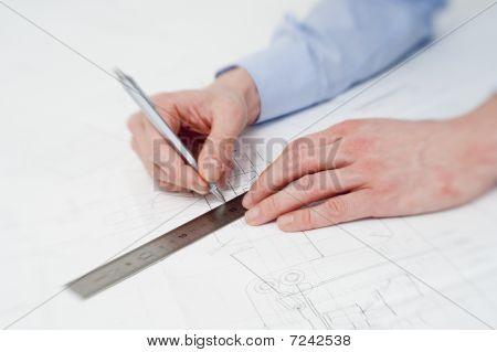 Engineer Making Adjustments In A Drawing