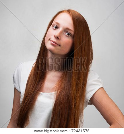 Young Red-haired Girl On Gray Background