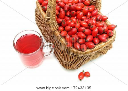 Wicker Basket With Berries Of Wild Rose And A Drink In A Glass Mug On A White Background