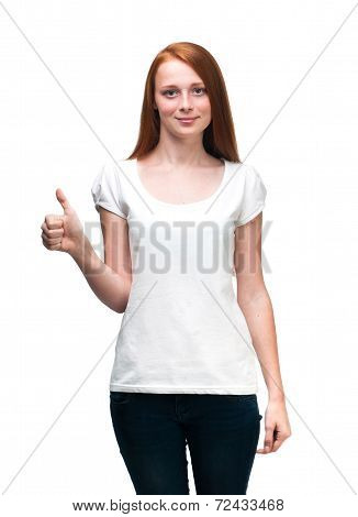 Red-haired Girl Shows  Finger On T-shirt. Isolated On White Background