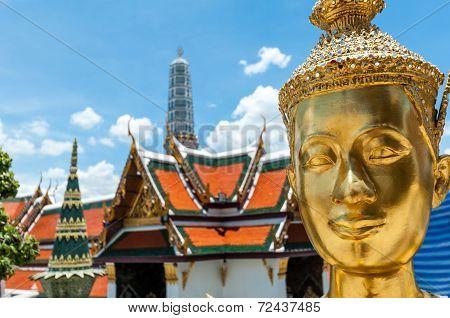 Golden Kinnari Statue At Temple Of Emerald Buddha (wat Phra Kaew) In Grand Royal Palace. Half-bird,