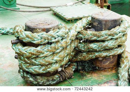 Green Rope On The Mooring Bollard