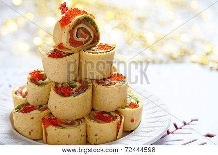 Salmon, cream cheese and iceberg lettuce pinwheels