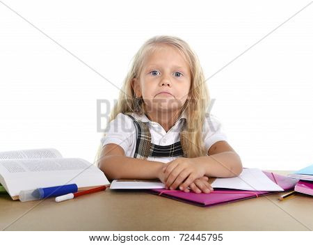 Sweet Little School Girl Tired And Sad In Stress With Books And Homework