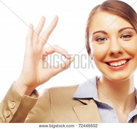 Happy smiling business woman with okay gesture