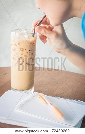 Woman Drinking Iced Milk Coffee