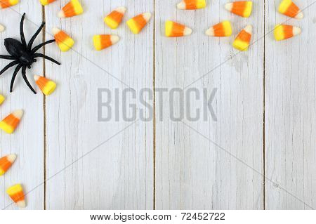Halloween candy on wood background