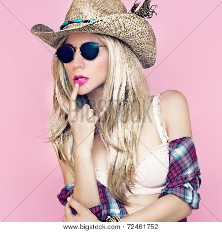 Sexy girl in cowboy fashion style