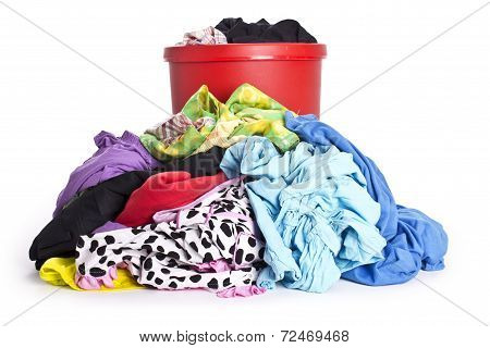unwashed cloth in the basket on white background