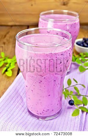 Milkshake With Blueberries In Glasses On Board