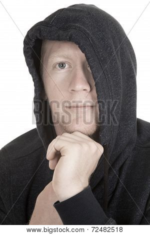 Man With Hoodie Over Part Of Face Hand On Chin