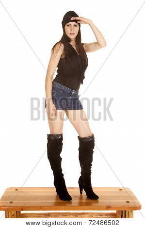 Woman Black Hat Boots Shirt Hand Above Eyes