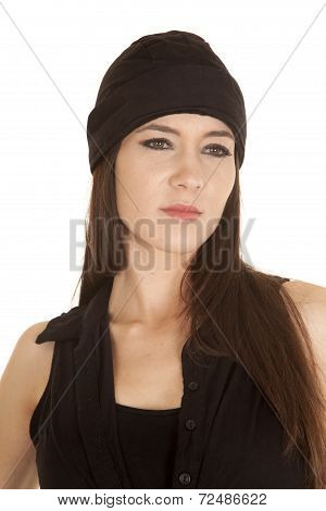 Woman Black Top And Black Hat Serious Look Side
