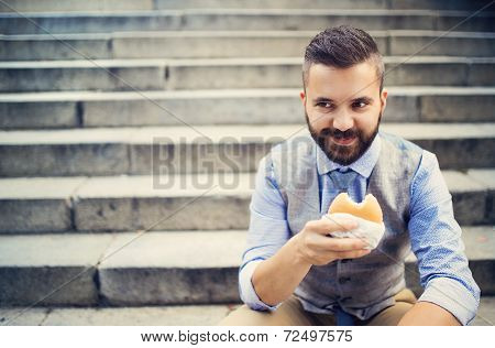 Hipster businessman during lunchtime bream