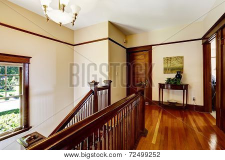Upstairs Hallway With Hardwood Floor And Staircase
