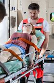 picture of stretcher  - Senseless girl lying on stretcher going to hospital - JPG