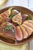 stock photo of duck breast  - Roasted duck breast with figs and rosemary in wine sauce  - JPG