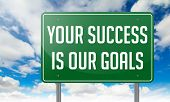 foto of slogan  - Highway Signpost with Your Success is Our Goals Slogan on Sky Background - JPG