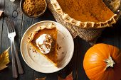 stock photo of food  - Homemade Pumpkin Pie for Thanksgiving Ready to Eat - JPG