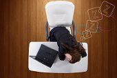 stock photo of sleepy  - sleepy young businesswoman at work being lazy or overworked - JPG