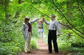 image of granddaughter  - Young Grandparents Playing With Their Baby Granddaughter In An Autumn Park - JPG