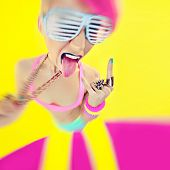 stock photo of swag  - Crazy bright  party girl on yellow background - JPG