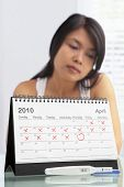 stock photo of pregnancy test  - Sad woman with negative pregnancy test and calendar - JPG