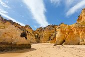 pic of vilamoura  - Rocky cliffs on the coast of the Atlantic ocean in Lagos Algarve Portugal - JPG