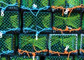 stock photo of lobster boat  - Closeup on Lobster pots on the dock England - JPG