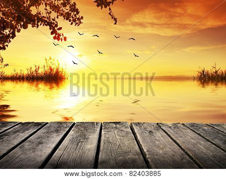 boardwalk along the river at dawn