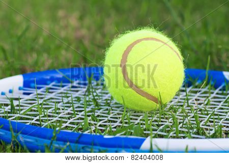 racket and tennis ball