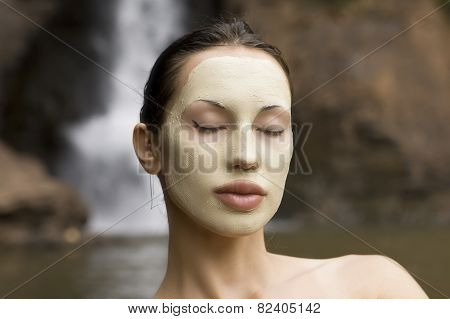Woman With Blue Clay Facial Mask In Beauty Spa.